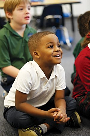 "Kindergartner Levi Brown of Faithful Shepherd Catholic School in Eagan reacts to the reading of the story ""Nicky and the Rainy Day"" by his teacher, Kathy Malmquist, during class"