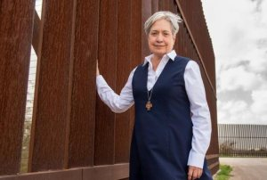 Sister Norma Pimentel, a member of the Missionaries of Jesus, is pictured along a border wall in late February. She is the executive director of Catholic Charities of the Rio Grande Valley in the Diocese of Brownsville, Texas.