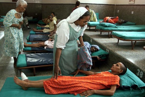 "A member of the Missionaries of Charity cares for a critically ill patient at Nrimal Hriday home for the dying opened in 1952 by St. Teresa of Kolkata in India. In his message for the World Day of the Sick, celebrated Feb. 11, Pope Francis said that life is ""a gift from God"" that is ""best suited to challenging today's individualism and social fragmentation."""