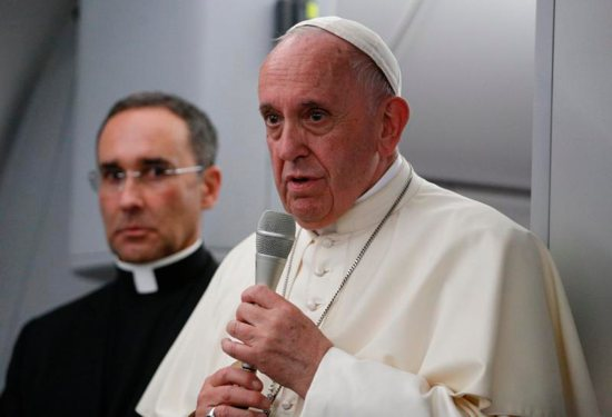 Pope Francis answers questions from journalists aboard his flight from Panama City to Rome, Jan. 27, 2019. Also pictured is Msgr. Mauricio Rueda, papal trip planner.