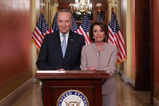 Senate Minority Leader Chuck Schumer, D-N.Y., and House Speaker Nancy Pelosi, D-Calif., pose for photographers Jan. 8 on Capitol Hill in Washington after concluding their joint response to President Donald Trump's prime-time address. Trump spoke from the Oval Office of the White House about immigration and the southern U.S. border on the 18th day of a partial government shutdown.