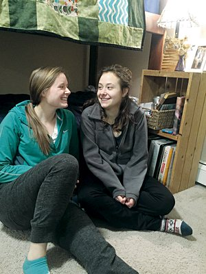 Clare, left, and Sarah Reinhardt are together at North Dakota State University in Fargo, N.D.,  two of seven Reinhardt children who have graduated or are in college.