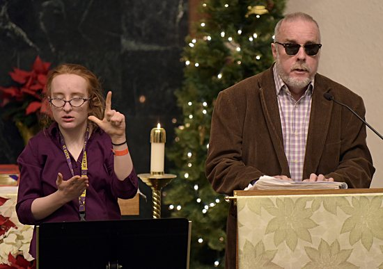Justin, right, and Maeve McDevitt use Braille and American Sign Language to proclaim the first reading during Mass Dec. 30 at Our Lady of Mount Carmel in northeast Minneapolis.