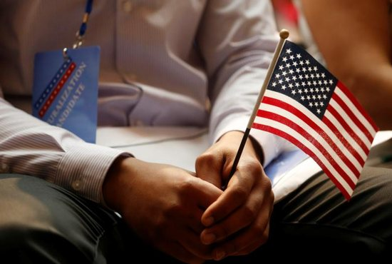 A new citizen holds a flag at the U.S. Citizenship and Immigration Services naturalization ceremony in the Manhattan borough of New York City July 3, 2018. The Supreme Court agreed Feb. 15, 2019, to hear oral arguments in April about the Trump administration's push to add a citizenship question to the 2020 census.