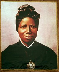 A tapestry portrait of St. Josephine Bakhita, an African slave who died in 1947, hangs from the facade of St. PeterÕs Basilica during her canonization in 2000 at the Vatican. St. Bakhita was born in the Darfur region of what is now Sudan. Her feast day is Feb. 8, the International Day of Prayer and Awareness against Human Trafficking.