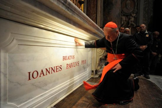 """Polish Cardinal Stanislaw Dziwisz prays at the tomb of St. John Paul II in St. Peter's Basilica at the Vatican May 3, 2011. Cardinal Dziwisz issued a statement March 20 vigorously defending the pontiff from """"hurtful and historically untrue"""" claims that he was """"slack"""" in combating sexual abuse by Catholic clergy."""