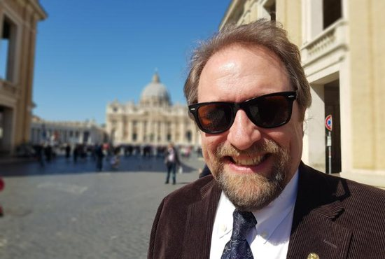 """U.S. scholar Dale Ahlquist, president of the Society of Gilbert Keith Chesterton, stands outside St. Peter's Square at the Vatican March 22, 2019. Ahlquist's latest book, """"Knight of the Holy Ghost,"""" highlights the life and works of English writer and philosopher G.K. Chesterton."""