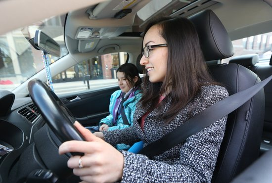Alejandra Chavez Rivas gets ready to drive her daughter, Daniela, home to Monticello March 26 after picking her up at St. Agnes School in St. Paul.