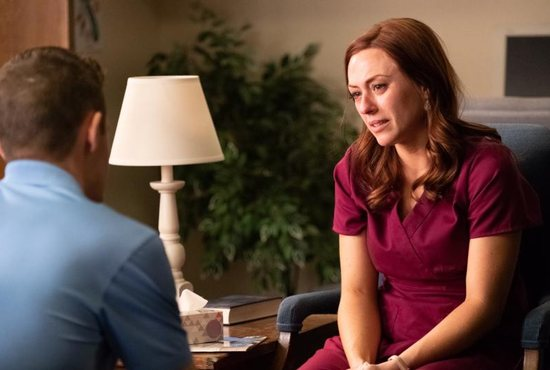 "Ashley Bratcher, who plays Abby Johnson, is pictured in a scene from the movie ""Unplanned,"" the story of Abby Johnson, a former Planned Parenthood clinic director, and her decision to join the pro-life movement. The Catholic News Service classification is A-III -- adults. The Motion Picture Association of America rating is R -- restricted. Under 17 requires accompanying parent or adult guardian."