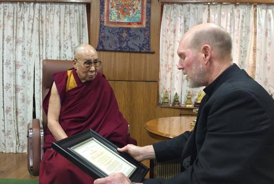 Bishop Thomas R. Zinkula of Davenport, Iowa, presents the Dalai Lama, the exiled spiritual leader of Tibet, with the Pacem in Terris Peace and Freedom Award at the Dalai Lama's residence in India March 4, 2019. The Dalai Lama is a renowned peacemaker and Nobel Peace Prize recipient.
