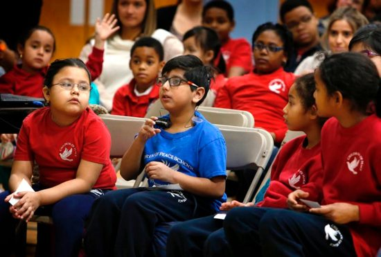 "Students at Children of Peace Catholic School in Chicago use sign language Feb. 22, 2019, to respond to actress Lauren Teruel Ridloff, a Tony Award nominee and currently a star of ""The Walking Dead"" series on AMC. Ridloff, who is deaf, graduated from in 1991 from the school, which at that time was called Holy Trinity School for the Deaf."