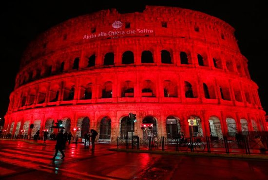 The Colosseum in Rome is lit in red to draw attention to the persecution of Christians around the world.