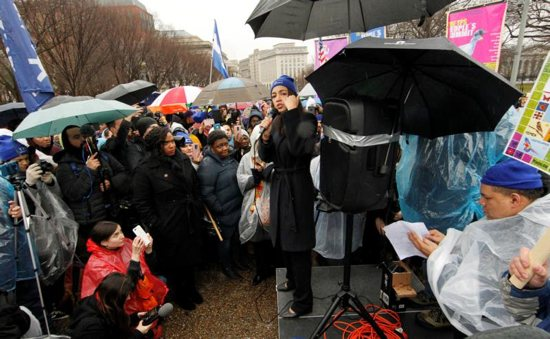 """U.S. Rep. Alexandria Ocasio-Cortez, D-N.Y., addresses immigration rights activists during a rally calling for """"permanent protections for Temporary Protected Status holders"""" in front of the White House in Washington Feb. 12, 2019. Due to a lawsuit, the Department of Homeland Security has extended TPS for El Salvador, Haiti, Nicaragua and Sudan to January 2020."""
