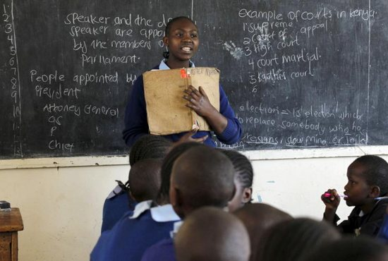 A young woman leads her classmates at a primary school in Nairobi, Kenya, Sept. 9, 2015. The empowerment of women was the focus of a March 19 panel discussion at the United Nations, with the speakers saying that women should not be required to divest themselves of femininity to achieve empowerment and gender equality.