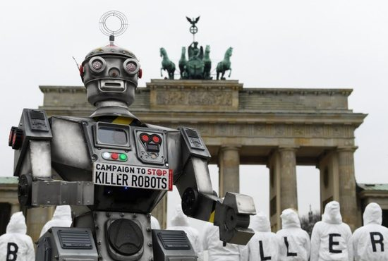 Activists from the Campaign to Stop Killer Robots, a coalition of nongovernmental organizations opposing lethal autonomous weapons, protest at the Brandenburg Gate in Berlin March, 21, 2019