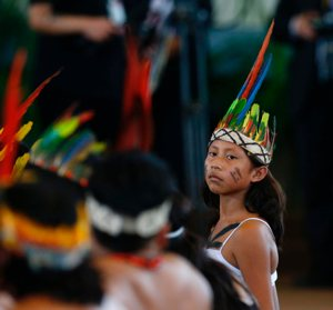 "A young member of an indigenous group from the Amazon region listens during a meeting with Pope Francis Jan. 19, 2018, at Madre de Dios stadium in Puerto Maldonado, Peru. The president of the Latin America Jesuit Conference said without the Amazon, ""we all go under."""