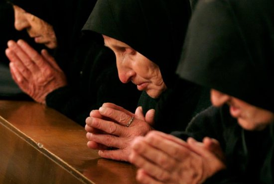 Bulgarian Catholic worshippers pray during Mass at St. Michael the Archangel Cathedral in Rakovski April 8, 2007. Pope Francis will visit Bulgaria May 5-7.