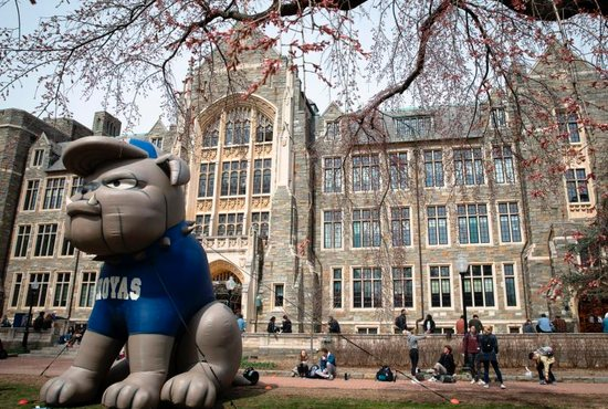 Students are seen on the campus of Georgetown University in Washington March 20, 2019.