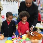 Archbishop Gregory visits Catholic Charities, school, residence for elderly