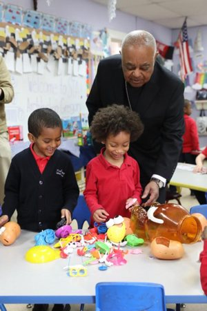 Archbishop Wilton D. Gregory greets students at St. Anthony Catholic School in Washington during a visit April 5, 2019, the day after Pope Francis named him as the new archbishop of Washington.