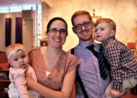 Christopher Booty, and his wife, Kristin, who attend Mass at Blessed Sacrament Church in Oakland Park, Fla., are shown with their babies, Catherine, and Maythan, March 24, 2019. The family, who are Muslims, will be converting to Catholicism during the Easter Vigil April 20.