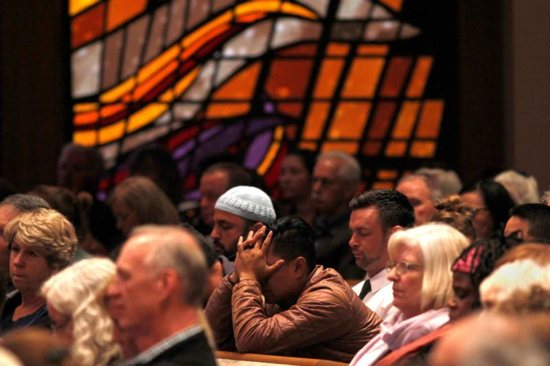 """A man reacts during a candlelight vigil April 27, 2019, at Rancho Bernardo Community Presbyterian Church for victims of a shooting incident at the Congregation Chabad synagogue in Poway, Calif., near San Diego. In response to the shooting, Cardinal Daniel N. DiNardo of Galveston-Houston and president of the U.S. Conference of Catholic Bishops, said in an April 28 statement: """"Our country should be better than this; our world should be beyond such acts of hatred and anti-Semitism."""""""