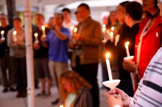 """A candlelight vigil is held April 27, 2019, at Rancho Bernardo Community Presbyterian Church for victims of a shooting incident at the Congregation Chabad synagogue in Poway, Calif., near San Diego. In response to the shooting, Cardinal Daniel N. DiNardo of Galveston-Houston and president of the U.S. Conference of Catholic Bishops, said in an April 28 statement: """"Our country should be better than this; our world should be beyond such acts of hatred and anti-Semitism."""""""