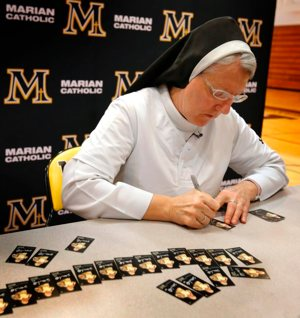 """Dominican Sister Mary Jo Sobieck, a theology teacher at Marian Catholic High School in Chicago, kicked off baseball season by debuting her very own 2019 Topps Allen and Ginter Baseball Trading Card April 8, 2019. Known as the """"Curveball Queen,"""" Sister Mary Jo signed 260 baseball cards that will be inserted into random Topps trading card packs."""