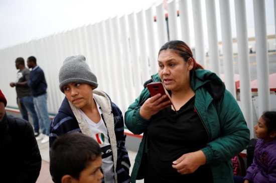 Asylum seeker Antonia Portillo Cruz speaks on the phone in Tijuana, Mexico, April 25, 2019, before crossing to the U.S. to appear in front of an immigration judge. During an April 30 hearing before the House Committee on Homeland Security Subcommittee on Border Security, Bishop Mark J. Seitz of the Diocese of El Paso, Texas, spoke of his border community's response assisting asylum-seeking families who have been released by the U.S. Department of Homeland Security.