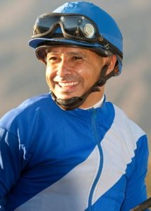 Jockey Mike Smith celebrates after winning the Grade I, $250,000 Santa Anita Sprint Championship aboard Points Offthebench, Oct. 5, 2013, at Santa Anita Park in Arcadia Calif.