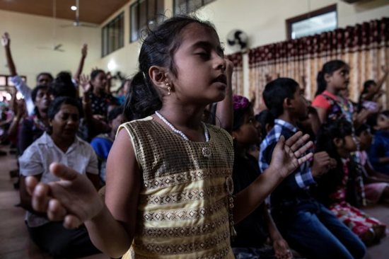 A young member of Zion Church, which was bombed on Easter Sunday, prays at a community hall in Batticaloa, Sri Lanka, May 5, 2019. In the wake of deadly Easter terrorist attacks on Sri Lanka churches and other sites, Pope Francis condemned the brutal killings and called on all Sri Lankans to strengthen efforts to foster peace and justice.