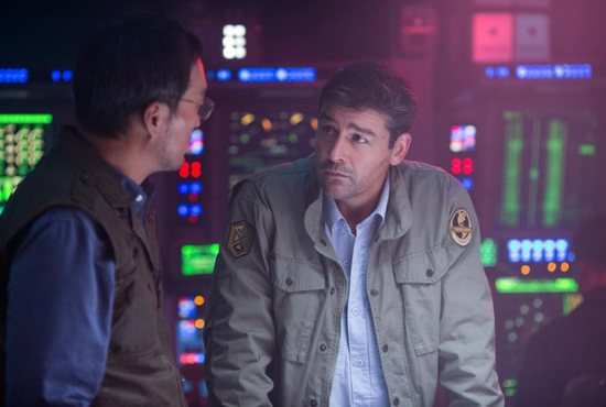 """Ken Watanabe and Kyle Chandler star in a scene from the movie """"Godzilla: King of the Monsters."""" The Catholic News Service classification is A-III -- adults. The Motion Picture Association of America rating is PG-13 -- parents strongly cautioned. Some material may be inappropriate for children under 13."""