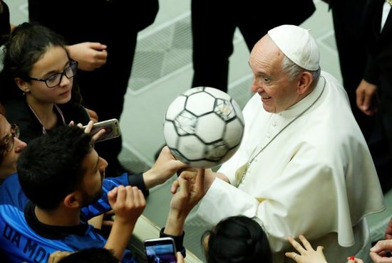 Pope Francis gestures as he participates alongside thousands of young soccer athletes in a project to promote the values of sport and soccer at the Vatican May 24, 2019.