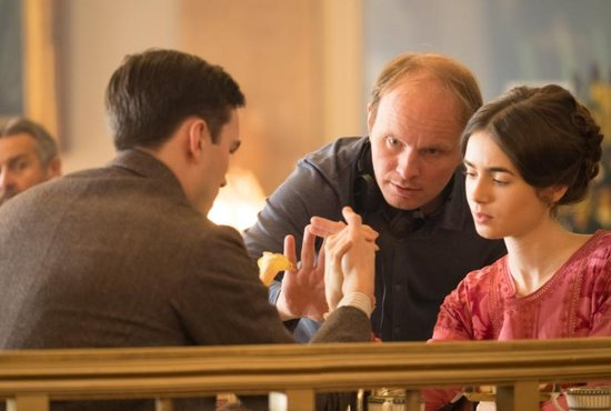 "Nicholas Hoult, director Dome Karukoski and Lily Collins are seen on the set of the movie ""Tolkien."""