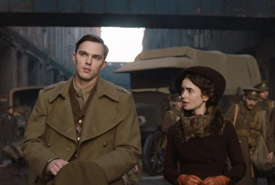 """Nicholas Hoult and Lily Collins star in a scene from the movie """"Tolkien."""" The Catholic News Service classification is A-II -- adults and adolescents. The Motion Picture Association of America rating is PG-13 -- parents strongly cautioned. Some material may be inappropriate for children under 13."""