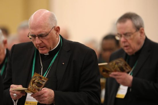Archbishop Joseph F. Naumann of Kansas City, Kan., chairman of the U.S. bishops' Committee on Pro-Life Activities, is seen during opening prayer on the first day of the annual general assembly of the USCCB in Baltimore June 11, 2019.