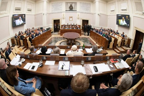 """Pope Francis speaks to executives of leading energy, petroleum and natural gas companies, leaders in investment firms and climate scientists during a meeting at the Vatican June 14, 2019. """"Today's ecological crisis, especially climate change, threatens the very future of the human family, and this is no exaggeration,"""" he told them."""