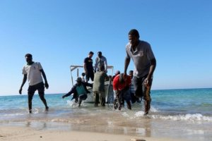 Migrants are seen after being rescued by the Libyan coast guard, in Tripoli, Libya