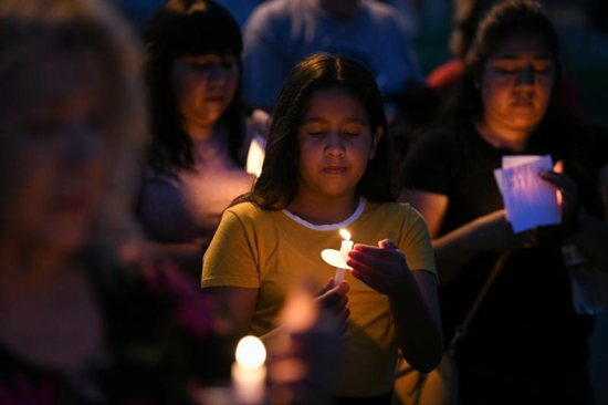 Mourners in Brownsville, Texas, honor the lives of Salvadoran migrant Oscar Alberto Martinez Ramirez and his 23 month-old daughter, Valeria during a vigil