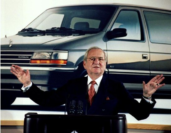 Former Chrysler CEO Lee Iacocca pictured in front of a minivan