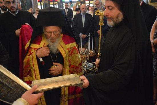Ecumenical Patriarch Bartholomew of Constantinople prays before a reliquary containing bone shards