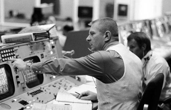 Flight director Gene Kranz is seen seated at his console in the mission operations control room in the Manned Spacecraft Center's Mission Control Center in Houston