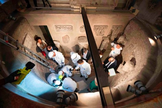 Workers inspect an ossuary at the Teutonic Cemetery at the Vatican