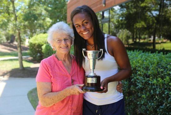 Joan Monti and Abbey Forbes hold the trophy July 22, 2019, that Forbes won at Wimbledon.