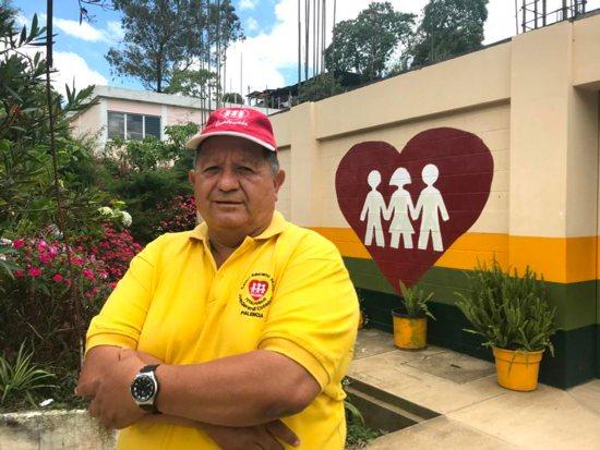 Carlos Rene Osorio, principal of the Jesuit-run Faith and Joy education center in Palencia, Guatemala, poses outside the school