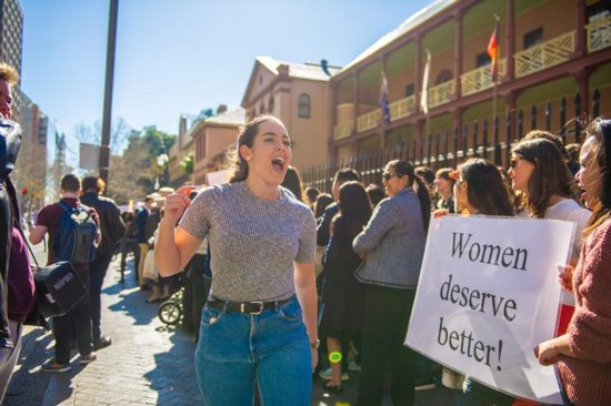 Bethany Marsh, a 23 year-old university student, leads pro-file supporters outside the New South Wales Parliament House in Sydney