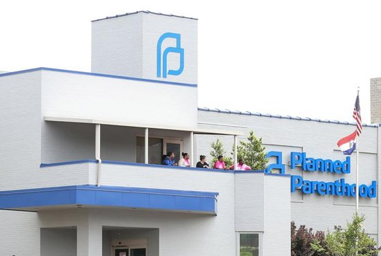 Planned Parenthood employees stand outside the facility