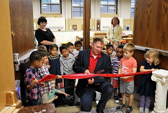 Kevin Ferdinandt, headmaster of St. Agnes School in St. Paul, cuts the ribbon