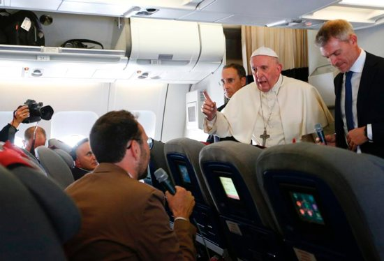 Pope Francis listens to a question from Jason Horowitz of The New York Times aboard his flight