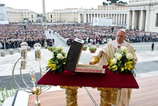 Pope Francis uses incense to bless a bronze reliquary